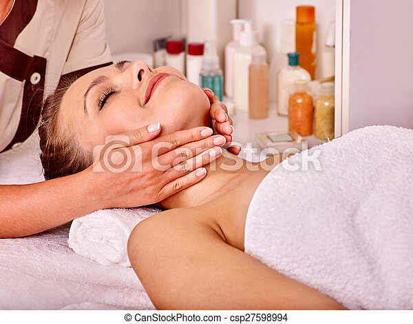 Woman getting  facial massage . - csp27598994