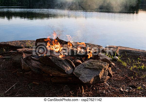 bonfire overlooking a lake
