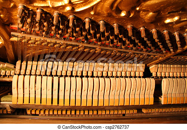 Inside an Upright Piano - Felt Hammers used to strike Steel Strings and wound knobs to tune. - csp2762737