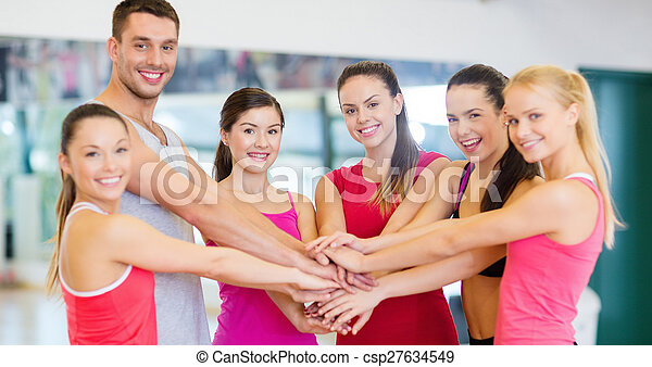 group of people in the gym celebrating victory