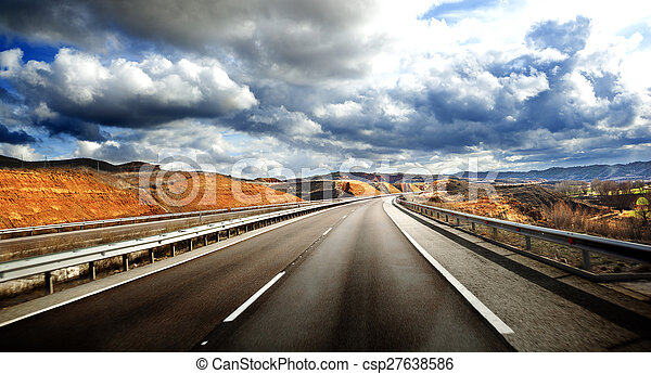 Road scenery. Travel concept.Cloudy sky and high road