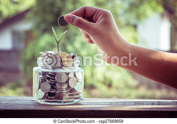 hand putting money coins with filter effect retro vintage style