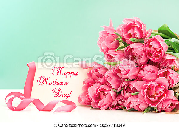 Pink tulips and greeting card. Happy Mothers Day