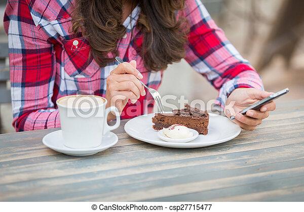 Woman Eating Cake at Cafe