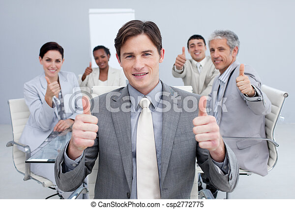 Attractive businessman celebrating a sucess with his team - csp2772775