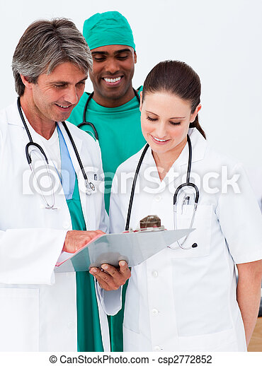 Medical team studying a medical history - csp2772852