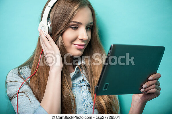 Cheerful Hipster woman with headphones and iPad
