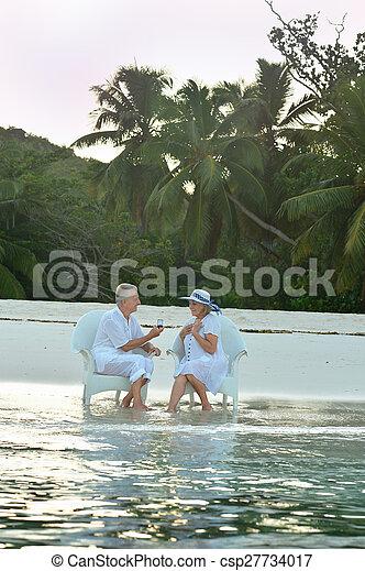 Elderly couple sitting outdoors