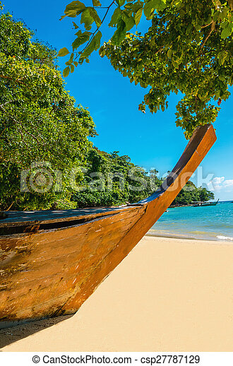 Stock Photo of Wooden boat on sandy shore of exotic beach - Wooden boat on... csp27787129 ...