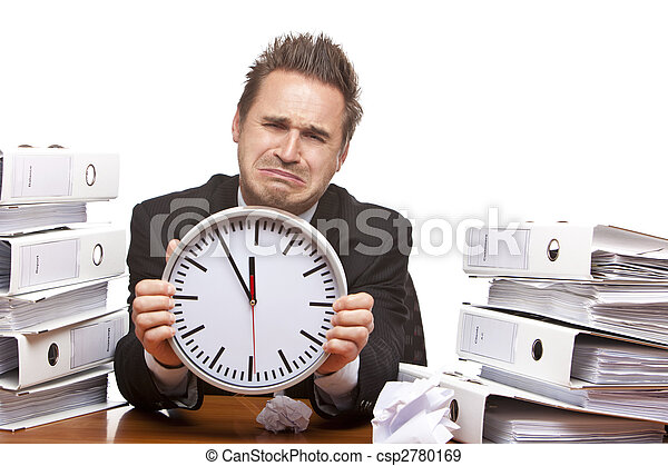 Stressed business man under time pressure cries in office - csp2780169