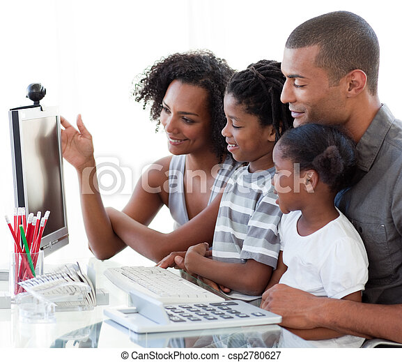 Afro-American family working with a computer at home - csp2780627