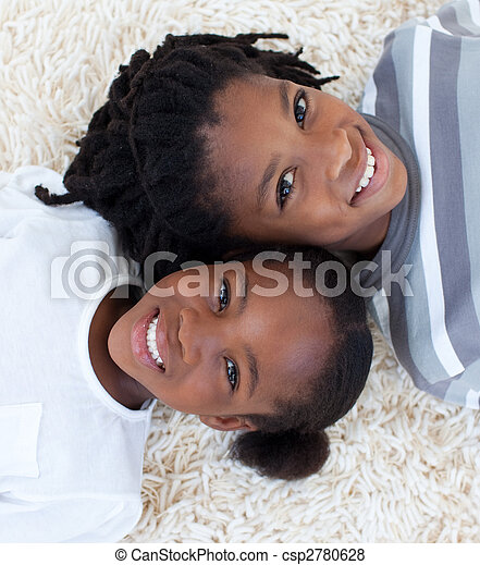 Portrait of Afro-American brother and sister on floor - csp2780628