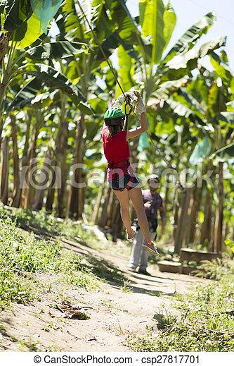 Happy Girl Enjoying Zip Adventure