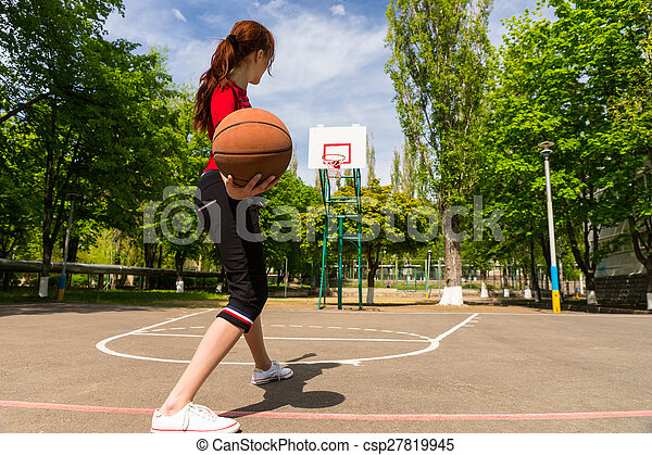 Woman Throwing Basketball from Top of Court Key