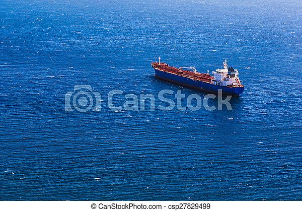 Container cargo ship in blue ocean