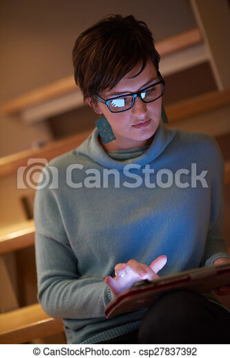 woman at home using tablet - csp27837392