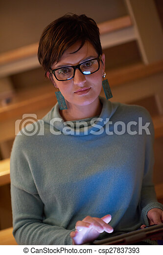 woman at home using tablet - csp27837393