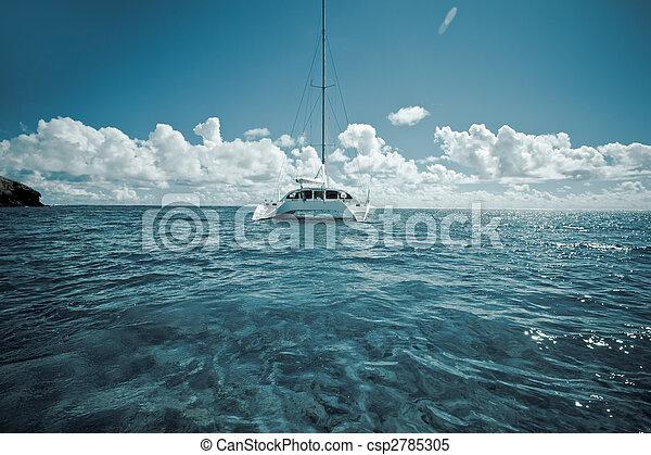 Katamaran on calm green shallow waters - csp2785305