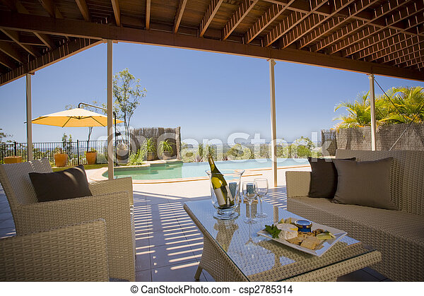 cheese and wine by the pool in the shade - csp2785314