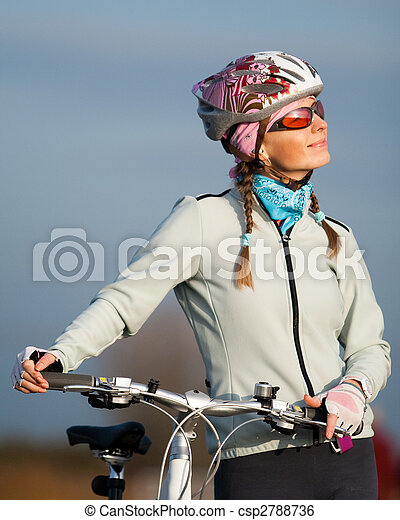 Active young woman with her bicycle - csp2788736