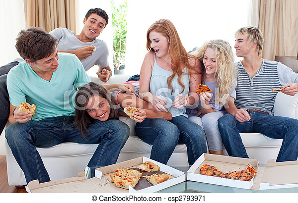 Adolescents eating pizza at home - csp2793971