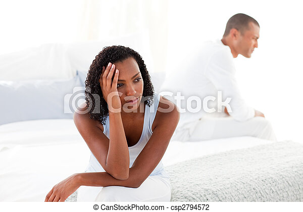 Upset young couple sitting on bed separately - csp2794572