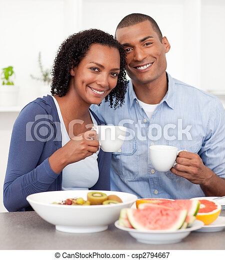 Portrait of an Afro-american couple having breakfast - csp2794667