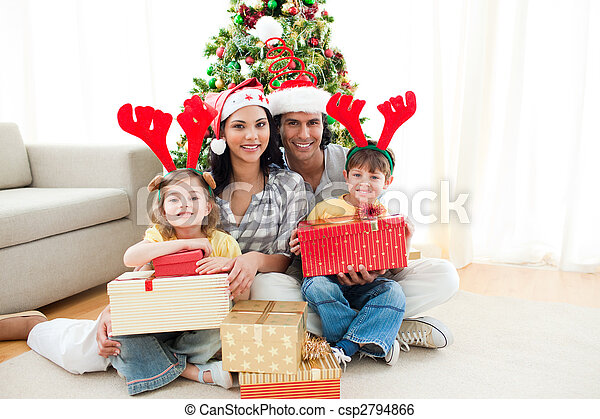 Family decorating a Christmas tree - csp2794866