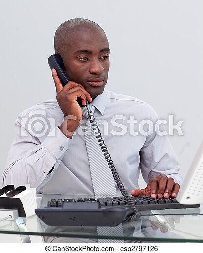 Afro-American businessman on phone in the office - csp2797126