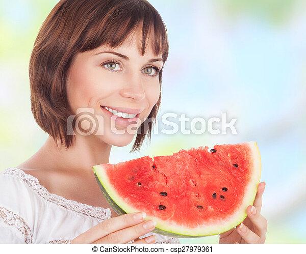 Beautiful woman eating watermelon - csp27979361