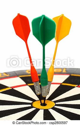 dartboard with darts in aim - csp2800597