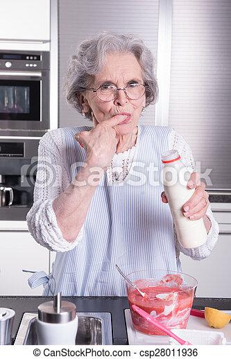 active female senior in kitchen