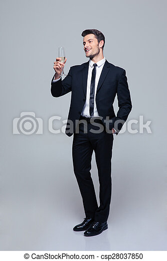 Smiling businessman holding glass of champagne