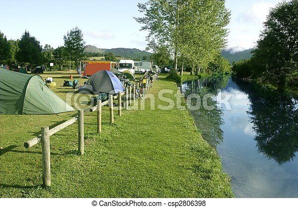 Camping tent field over green grass - csp2806398