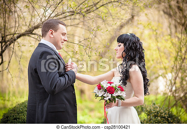 The groom kisses a hand