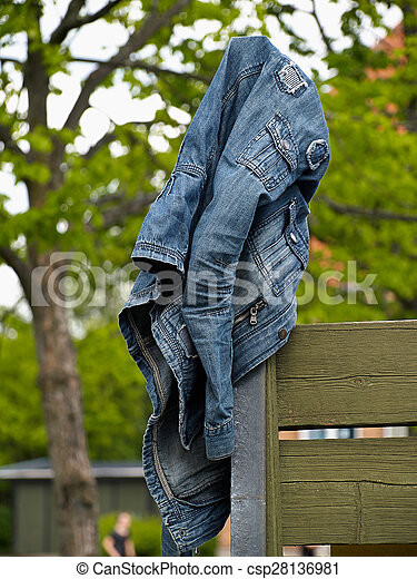 Pictures of Blue jeans denim jacket hanged on a wooden fence ...