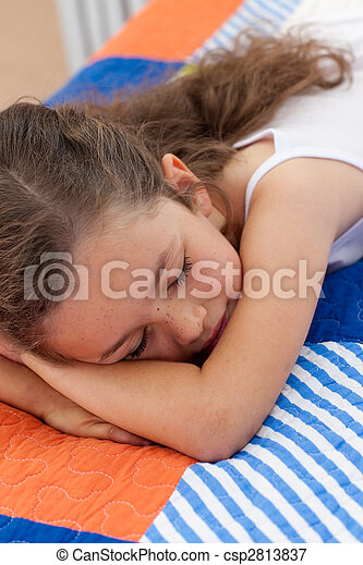 Pretty little girl sleeping on bed - csp2813837