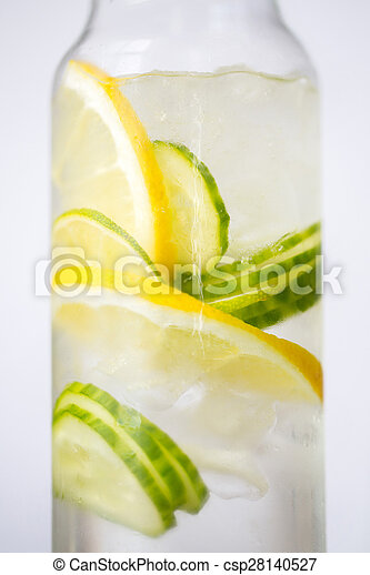 close up of fruit water in glass bottle