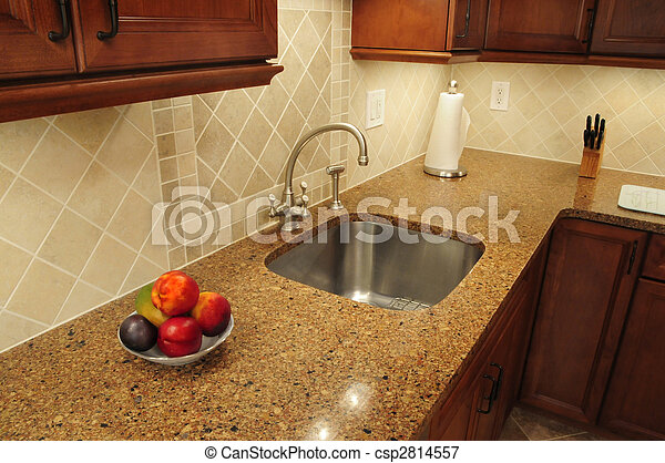 Stainless steel sink in a remodeled kitchen - csp2814557