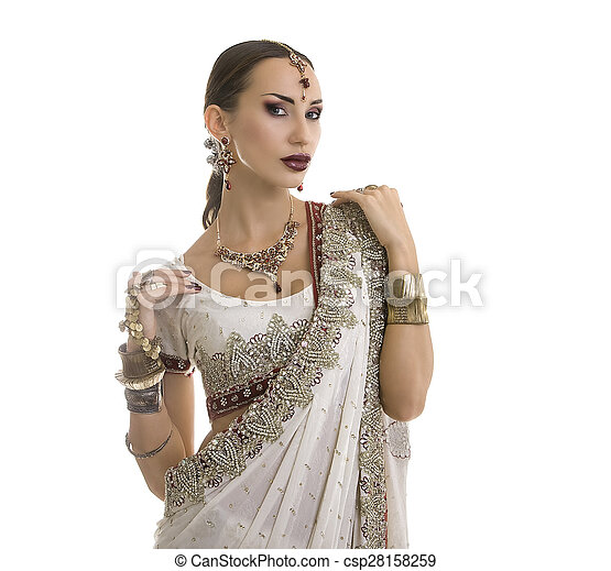 Beautiful Indian Woman in Traditional Sari Clothing with Bridal Makeup and oriental jewelry.  - csp28158259