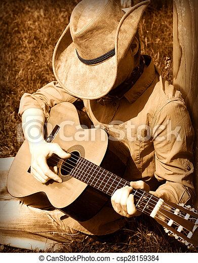 Cowboy plays guitar