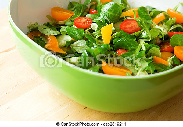 Eat healthy! Fresh vegetable salad served in a green salad bowl - csp2819211