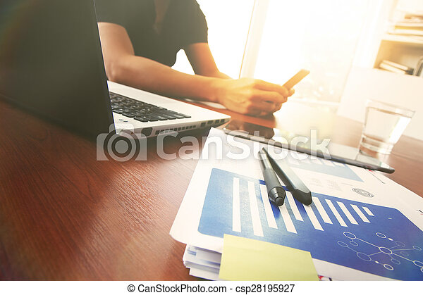 Young creative designer man working at office and social network media and graph chart diagram as concept
