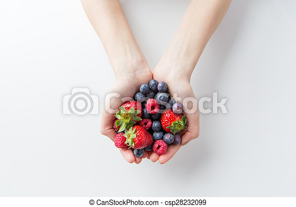 close up of woman hands holding berries