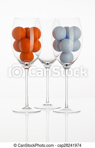 Wineglass with golf balls - csp28241974