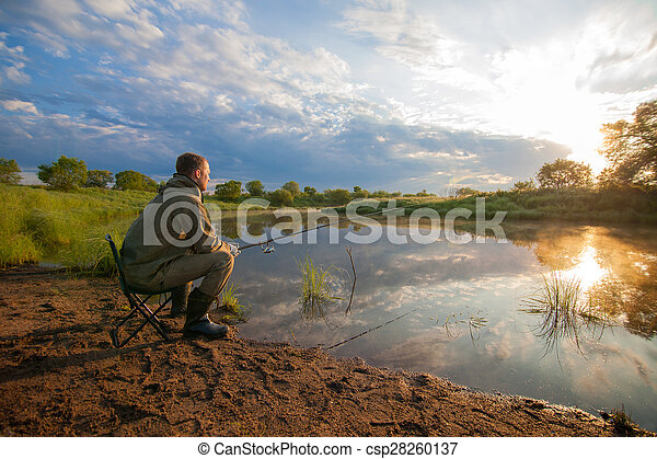 Stock photos of fisherman with fish rod in his hands near for Stocked fishing ponds near me