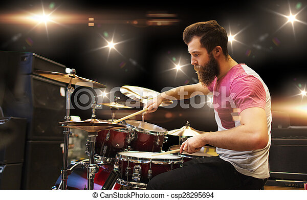 male musician playing cymbals at music concert