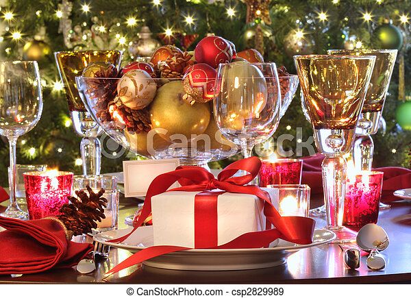 Holiday table setting with red ribboned gift - csp2829989