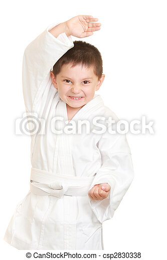 Funny karate kid in defense stance - csp2830338