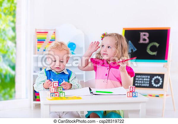 Kids at preschool painting